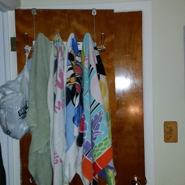 hang wet towels on over the door hooks